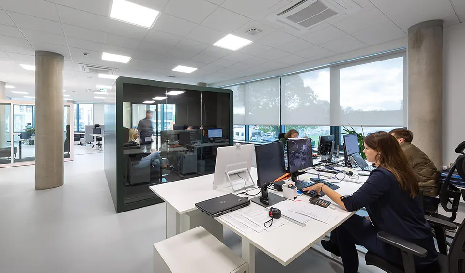 An occupied Space 6 in the center of an open office